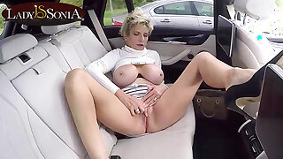 Busty Lady Sonia masturbates in the backseat of her car