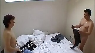 Swinger couple fucking in a room