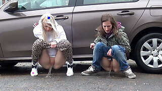 Blonde And Brunette Squat And Piss Together