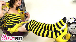 Sexy girl in a bee cosplay costume and striped stockings